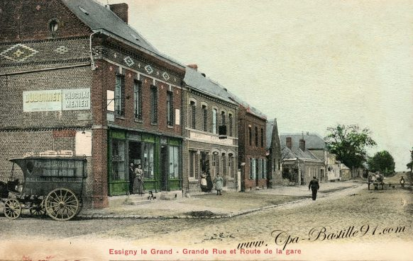 Carte Postale Ancienne d'Essigny-le-Grand - Grande rue et Route de la Gare